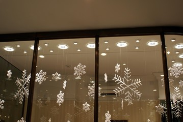 christmas decoration at night.lights.window.glass