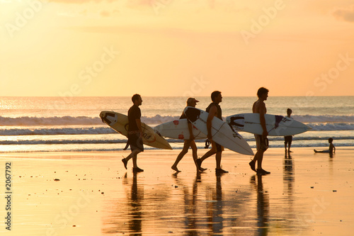 surfers at sunset - 2067792