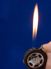 lighter in the form of wheel on blue background