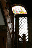 stained glass window by the stair case poster