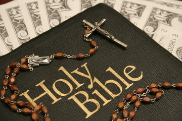holy bible, rosary & money