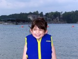 child in life jacket poster