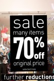 sign.sale.many items 70% off.fruther reduction.sto poster