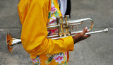 close-up of a band member holding a trumpet poster