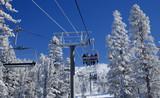 riding a lift on a ski resort. poster