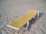 single yellow deck chair with copyspace poster