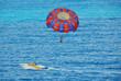 parasailing on tropical beach - 2112156