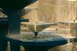 fountain against bright sun poster