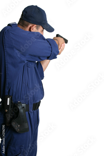 security officer aiming a gun
