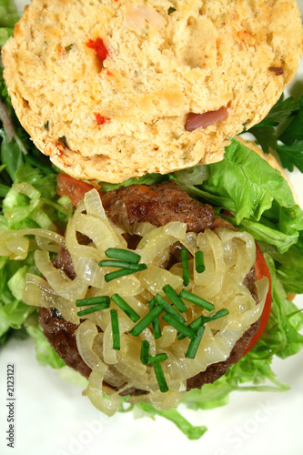 gourmet beef burger on a herb roll