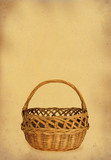 wicker basket against stained retro paper poster