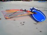 wind sruf board lying on the beach at bintan, indo poster