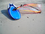 wind surf board lying on the beach at bintan, indo poster