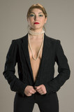 topless model in black suit with pearl necklace poster