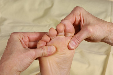 reflexology foot massage hands on