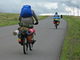 three cyclists go to road. poster