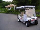 parked golf buggy with copyspace poster