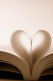 pages of a book curved into a heart shape (sepia) poster