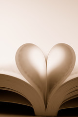 pages of a book curved into a heart shape (sepia)