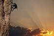 Leinwandbild Motiv climber on sunset on the rock