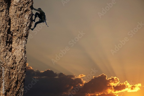 Fotobehang Alpinisme climber on sunset on the rock