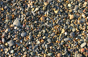 colorful beach pebbles, aberystwyth, wales.
