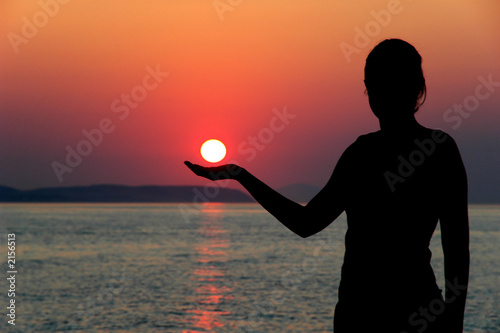a girl holding the sun