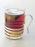 glass of a strong hot tea poster