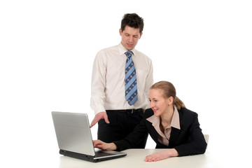 business couple working on laptop