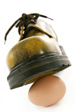 boot crushing an egg poster