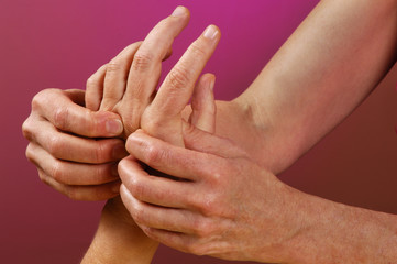 spa reflexologist hand massage treatment