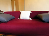 red sofa and white pillow poster