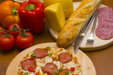 pizza with salami and ingredients poster