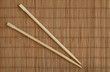 chopsticks and bamboo mat