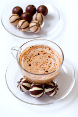 cup of cappucino and candies