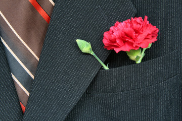 suit and flower