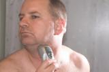 man shaving poster