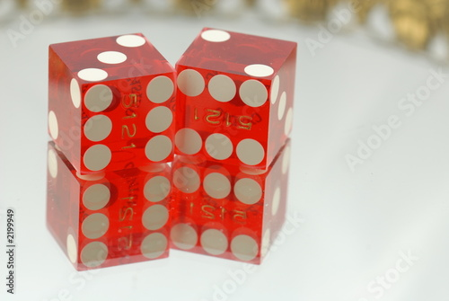 red dice on mirror