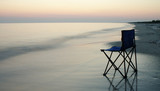 folding chair on a seaside poster