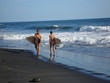 surfer girls at el tunco beach - el salvador
