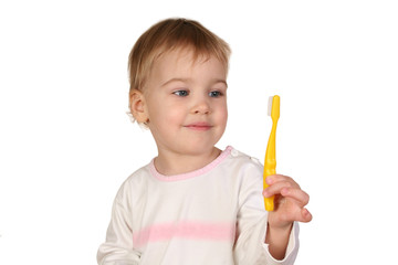 baby with tooth brush