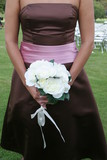 brown dress gown pink belt white rose bouquet poster
