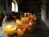 lamps at buddhist temple poster