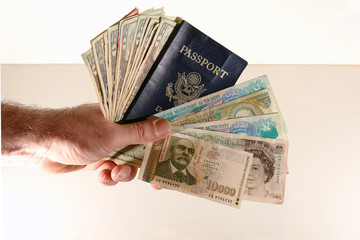 man holding passport and currency