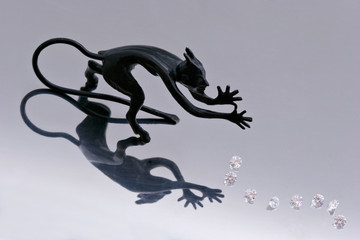 figure of imp with diamonds