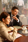 business man and woman talking in the office envir poster