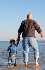 father and son at shore