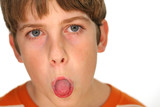 young boy sticking out his tongue poster