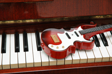 guitar on the piano keys