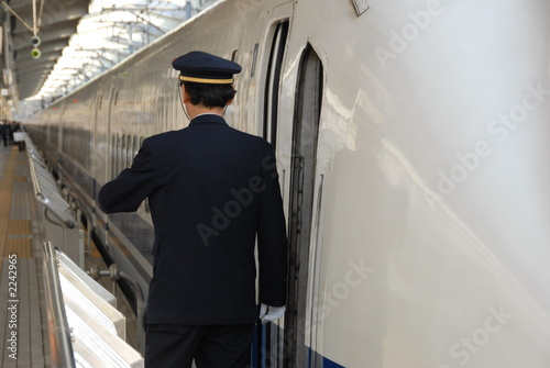 guard on train platform